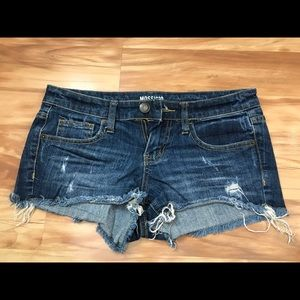 Low-rise distressed denim shorts